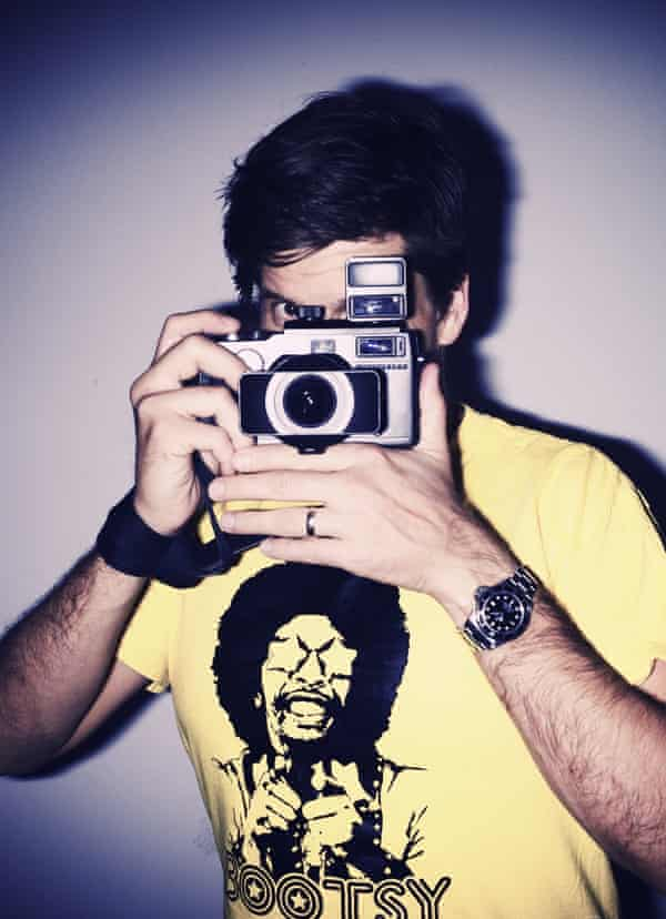 Osher holding his 'holy grail' camera – a Hasselblad Xpan.