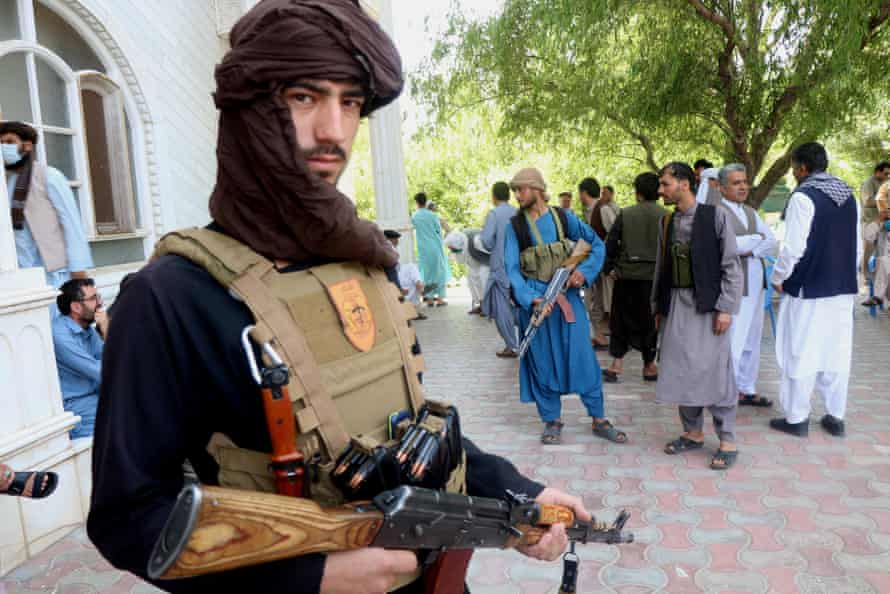 Armed supporters of former Mujahideen commander Ismail Khan, guards his residence during a gathering to devise strategies for the defence of their region as they vow to fight side-by-side with Afghan security forces in Herat, Afghanistan, 09 July