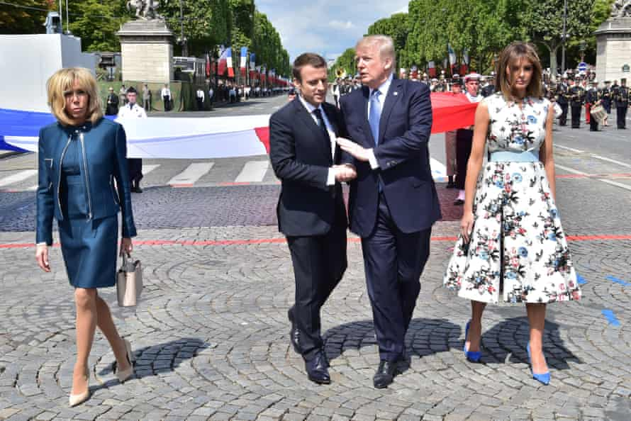 Embarrassed or exhilarated? Brigitte Macron and Melania Trump stand either side of the French and US presidents.