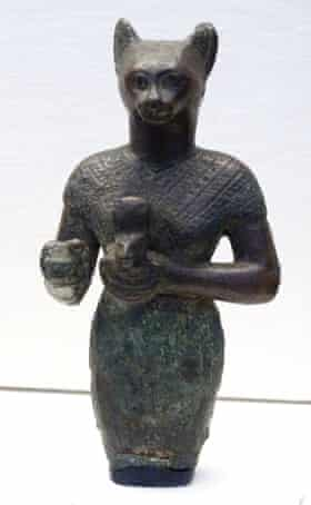 Upper portion of a bronze figure of Bastet holding a cat aegis. From the late period. Dated 600 BC.