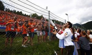 Daniel Ricciardo fires T-shirts into a crowd of largely Dutch fans at the Austrian Grand Prix.