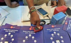 Money transfer customer uses fingerprint scanner