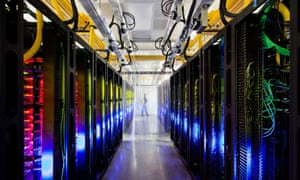 Google Reveals Top-Secret Data centers - 17 Oct 2012Mandatory Credit: Photo by KeystoneUSA-ZUMA / Rex Features (1930453m) Council Bluffs, Iowa, U.S. - A collection of switches and routers that keep Google's data centers in contact. The fiber optic networks connecting our sites can run at speeds that are more than 200,000 times faster than a typical home Internet connection. The fiber cables run along the yellow cable trays near the ceiling. Google Reveals Top-Secret Data centers - 17 Oct 2012