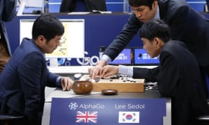 Go player Lee Sedol, seated right, reviews the game after losing to AlphaGo.