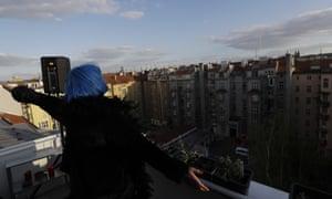 Singer on Prague balcony