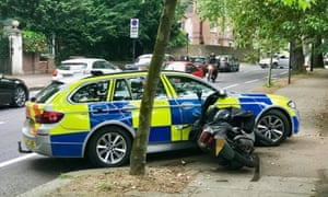 A moped stopped by a police vehicle following a pursuit in 2018.