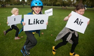"children run outside with signs that read ""I like clean air"""