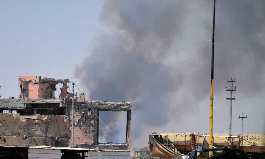 Smoke rises above a building following a US-led coalition air strike against Isis positions during a military operation to regain control of the eastern suburbs of Ramadi, Iraq, earlier this month.