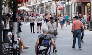 People in Las Palmas de Gran Canaria on the day Spain's government has banned smoking in public.