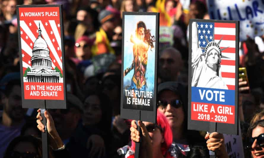 Protesters attend the Los Angeles rally on the anniversary of the Women's March. Women now make up almost 20% of Congress.