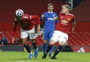 Manchester United's Mason Greenwood, left, scores his side's second goal.