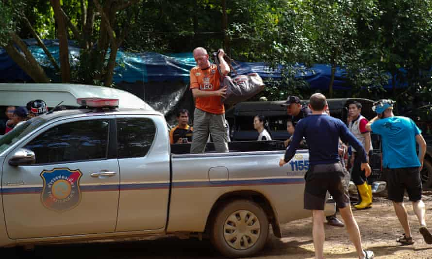 British caver Vernon Unsworth, centre, gets out of pick up truck