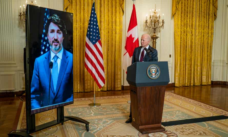 Joe Biden and Justin Trudeau deliver opening statements via video link in the East Room of the White House