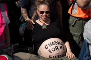 Wellington, New Zealand A pregnant activist with a message on her belly protests in front of Parliament