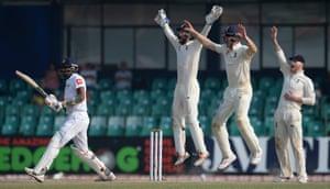 Suranga Lakmal of Sri Lanka is dismissed as Ben Foakes, Keaton Jennings and Ben Stokes celebrate.