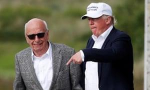 Rupert Murdoch and Donald Trump walk round Trump International Golf Links in Aberdeen.