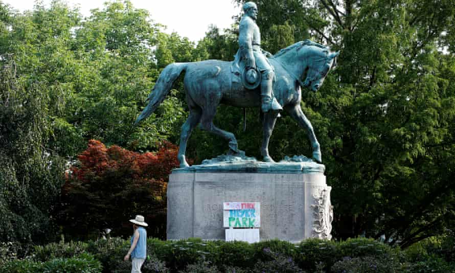 A sign on the statue of Robert E Lee calls for the park to be renamed for Heather Heyer in Charlottesville, Virginia Wednesday.