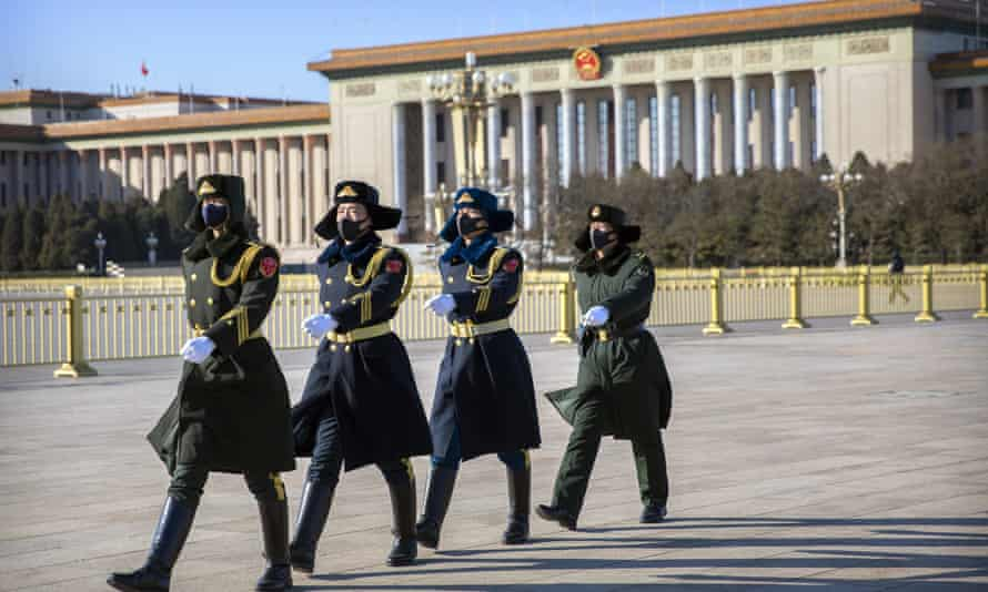 Chinese guards wear face masks as they march in  Tiananmen Square in Beijing.