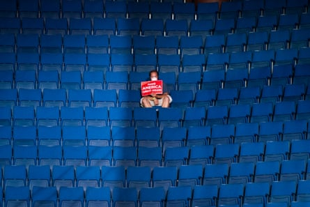 A supporter sits alone in the top sections of seating as Mike Pence speaks before Trump arrives for a rally at the BOK Center in Tulsa, Oklahoma, in June.