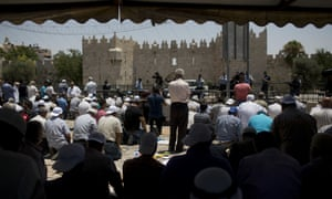 Worshipers prevented from entering the al-Aqsa Mosque gather for Friday prayer outside Jerusalem's Old City.