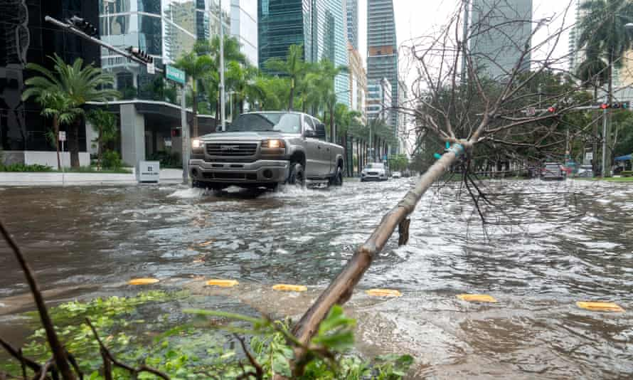 Downtown Miami on Monday. 'In some areas, the water isn't pumping out as fast as it's coming in,' warned Miami-Dade commissioner Jose Diaz.