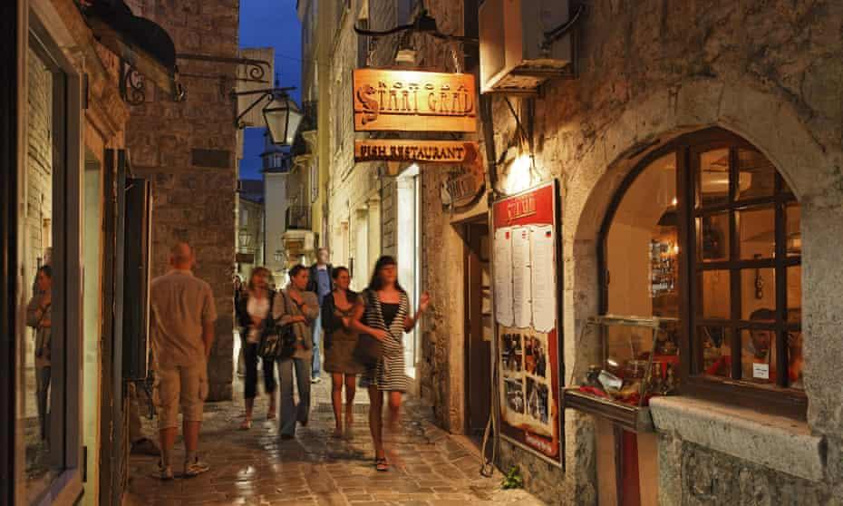 Visitors take an evening stroll in Budva