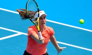 Johanna Konta of Britain serves during a practice match with Alison Riske of the US before the Australia Open in Melbourne.