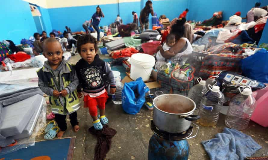 African migrants who fled battle zones in Libya gather at a detention center in Zawiya, west of the capital Tripoli.
