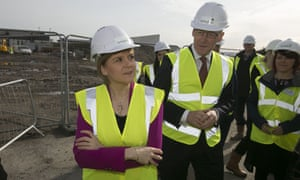 Scotland's first minister, Nicola Sturgeon, and its finance secretary, John Swinney, visit a construction site for new homes in Braehead in April.