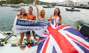 The Row Like a Girl team celebrate at the end of their 2,700 nautical mile journey.