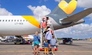 Passengers boarding a Thomas Cook aircraft at Malta International Airport which is bound for the UK
