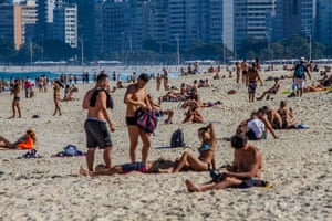 Even with the creation of a fine for bathing in the sea and sitting on the beach sand decreed by the city to stop the spread of coronavirus, bathers frequent Leme beach in Rio de Janeiro on Saturday, 11 July 2020.