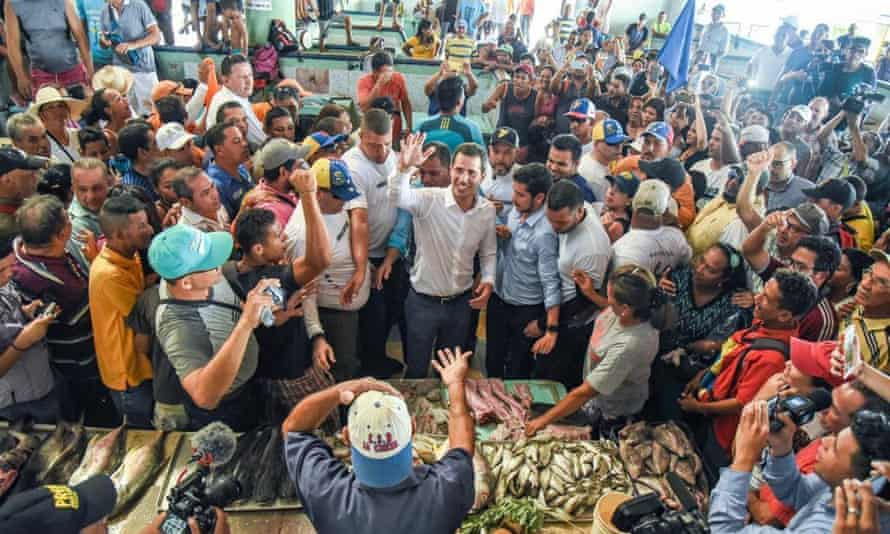 Juan Guaidó has been touring his country in an effort to keep his campaign alive. Here he greets supporters at Los Cocos municipal fish market in Porlamar, Margarita Island.