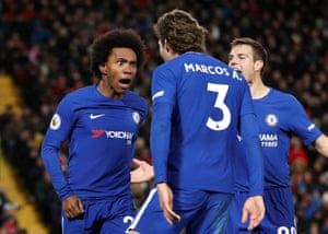 Willian celebrates with Marcos Alonso and Cesar Azpilicueta.