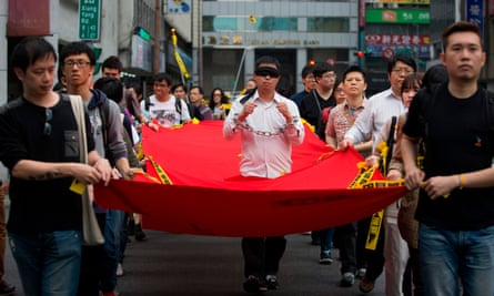 Activists march during a protest over China's imprisonment of Taiwanese human rights activist Lee Ming-Ches