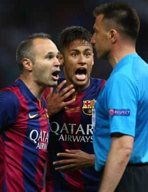 Andres Iniesta and Neymar of Barcelona confront the assistant referee who disallowed the goal.