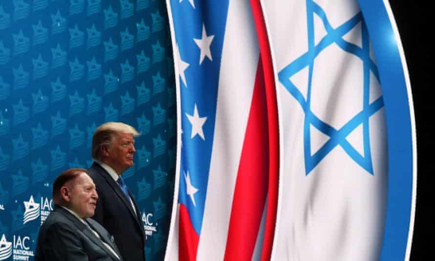 Donald Trump stands on stage alongside Sheldon Adelson before delivering remarks at the Israeli American Council National Summit in Hollywood, Florida, on 7 December 2019.