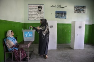 An Afghan woman casts her vote in Kabul on Saturday.