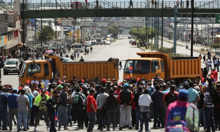 Trucks block main roads Monday during protests after Ecuador's President Lenin Moreno's government ended four-decade-old fuel subsidies.