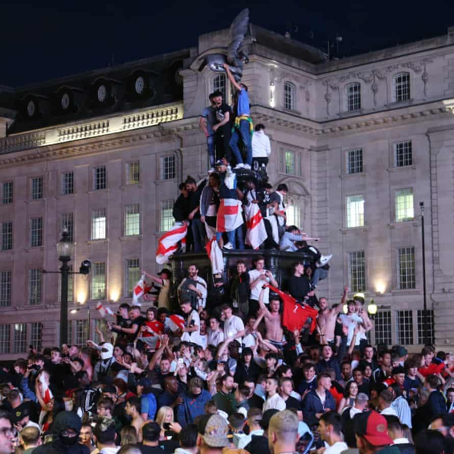 Fans of England celebrate after winning the quarter final match against Ukraine.