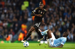 Yaya Toure attempts a tackle on Paul Pogba.