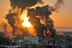 A fire rages at sunrise in Khan Yunis following an Israeli airstrike on targets in the southern Gaza Strip