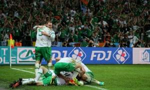 Robbie Brady of Ireland celebrates with his team-mates after scoring.