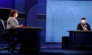 Deputies to the vice presidential candidates sit on stage in Salt Lake City, where plexiglass panels have been installed as additional protection against the coronavirus.
