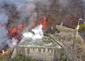 Hot lava reaches an irrigation pond in La Palma, Spain