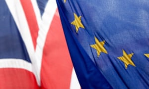A Union Jack flies next to an EU flag in London