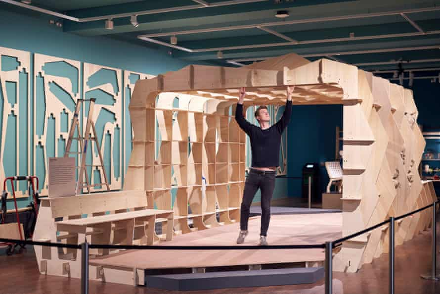 Pop-up protection … the Global Clinic plywood concept by Rogers Stirk Harbour being assembled at the exhibition.