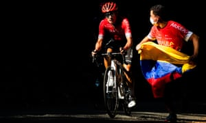 Dayer Quintana of Arkea Samsic is chased by a fan on the Montee de la Selle de Fromentel.