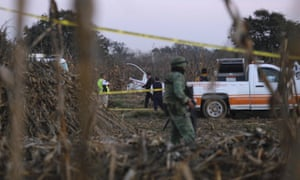 Authorities investigate the area where the helicopter carrying the governor of Puebla, Martha Erika Alonso, and her husband, Senator Rafael Moreno, crashed