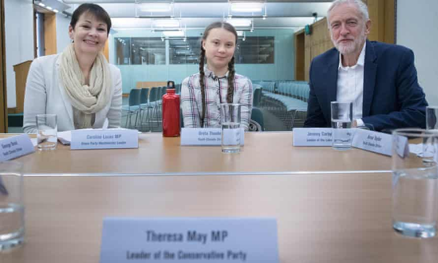 A name plate marks a place for the absent prime minister as Caroline Lucas and Jeremy Corbyn meet Greta Thunberg.